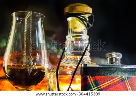 Alcoholic drink background with open fire . Whisky, whiskey, brandy, cognac, liqueur