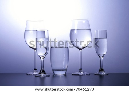 Alcoholic glasses line next to each other. - stock photo