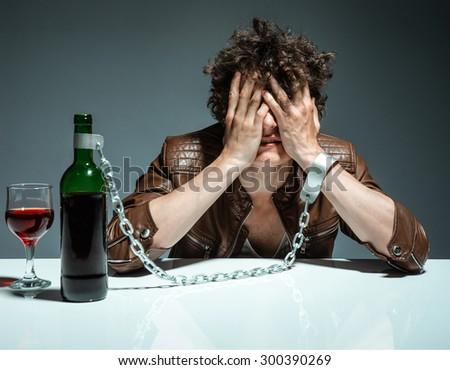 Alcoholic in despair / photo of youth addicted to alcohol, alcoholism concept, social problem - stock photo