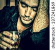 Alcoholism : Grunge blue toned portrait of a lonely and desperate drunk hispanic man - stock photo