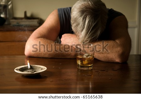 Alcoholism: portrait of a lonely, desperate man - stock photo