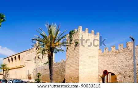 Alcudia Sant Jaume church near roman castle wall Mallorca island in Balearic Spain - stock photo
