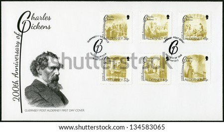 ALDERNEY - CIRCA 2012: A stamp printed in Alderney shows Charles Dickens (1812-1870), illustrations from Oliver Twist by George Cruikshank (1792-1878), 200th anniversary of Charles Dickens, circa 2012 - stock photo