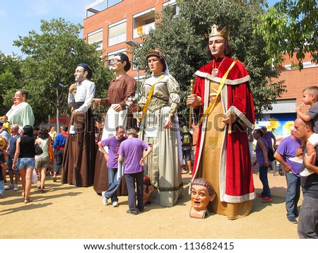 ALELLA, SPAIN - SEPTEMBER 09: Some unidentified people at La Verema Wine Festival, a traditional party of Alella, with a traditional parade of Giants, on September 9, 2012 in Alella, Barcelona, Spain.