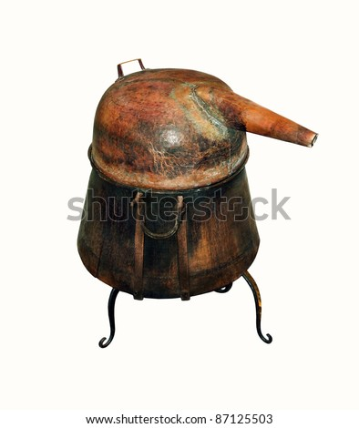 Alembic Copper - Distillation apparatus employed for the distillation of alcohol, essential oils and moonshine.Old wine distillery for the home made alcohol isolated on white. - stock photo