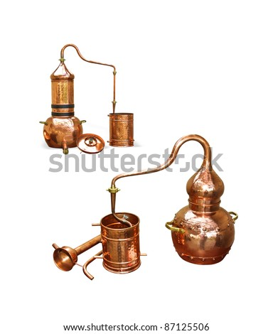 Alembic Copper - Distillation apparatus employed for the distillation of alcohol, essential oils and moonshine. Modern wine distillery for the home made of the wine isolated on white. - stock photo