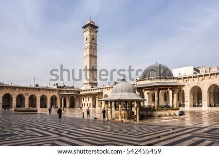 ALEPPO, SYRIA - DECEMBER 28, 2010: People on yard of Umayyad mosque in the historical center of Aleppo (Halab) at the end of 2010 shortly before start of Syrian civil war