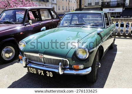 ALES, FRANCE - APRIL 11: MG sports car of the 1950s photographed vintage car rally Town Hall Square in the town of Ales, in the Gard department, April 11, 2015.