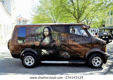 ALES, FRANCE - APRIL 11: Van Bedford 1980 painted on the theme of Leonardo da Vinci photographed at the rally of vintage cars on the Town Hall Square of the city of Ales, April 11, 2015. - stock photo
