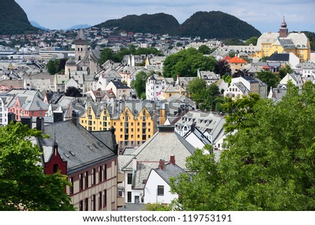 Alesund is a sea port, and is noted for its unique concentration of Art Nouveau architecture. The Norwegian Centre of Art Nouveau Architecture, Jugendstilsenteret, is situated in Alesund. - stock photo