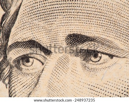 Alexander Hamilton eyes extreme macro on US 10 dollar bill, united states money closeup, 2013 series - stock photo