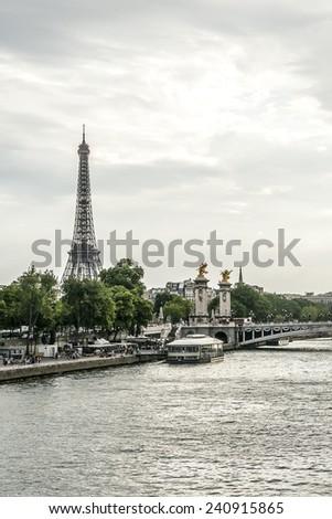 Alexander III Bridge across Seine River and Tour Eiffel (Eiffel Tower) at sunset. Paris France. - stock photo