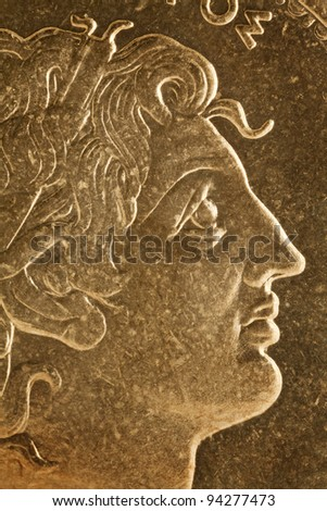 Alexander the Great profile portrait, Greek king of Macedon  - magnified detail from old scratched coin - stock photo