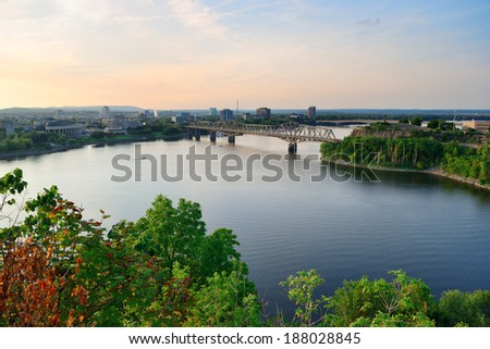 Alexandra Bridge over river in Ottawa at sunset