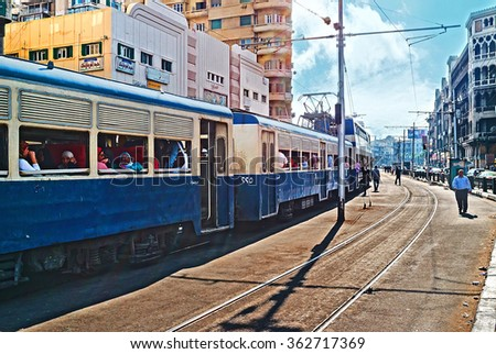 ALEXANDRIA, EGYPT - OCTOBER 11, 2014: The crowded trams consist of two or three wagons, including the double-deck, on October 11 in Alexandria.