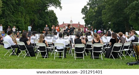 ALEXANDRIA, VA - AUGUST 3, 2013: Irvine Classical Players Seraphim Symphony, on tour from Irvine, CA., performed for crowds of tourists at George Washington's Mount Vernon in front of the Mansion. - stock photo
