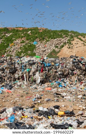 ALEXANDROUPOLIS, GREECE - MARCH 30: A section of a landfill located on March 30, 2014 in Alexandroupolis, Greece. Though forbidden this way for the municipality garbage, still exists.  - stock photo
