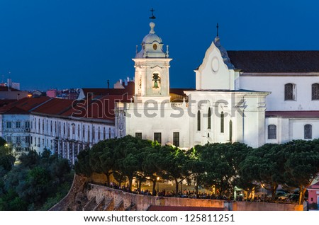Alfama district of Lisbon, one of the oldest in the capital of Portugal, with the building of Convent of the Grace - stock photo