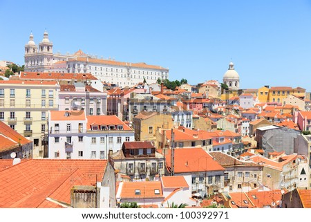 Alfama oldest district scenic view from miradouro de Santa Luzia. Roofs, Monastery of Sao Vicente de Fora and Church of Santa Engracia. Lisbon, Portugal, Europe. - stock photo