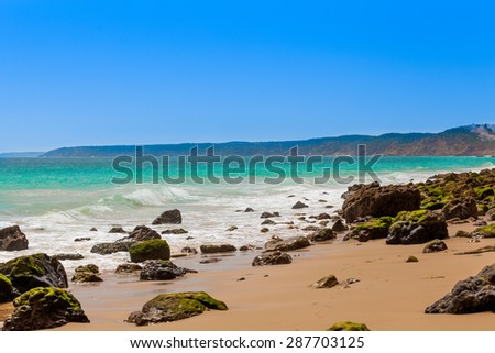 Algarve, Portugal, Europe.  Atlantic coast.  ocean waves of Atlantic Ocean