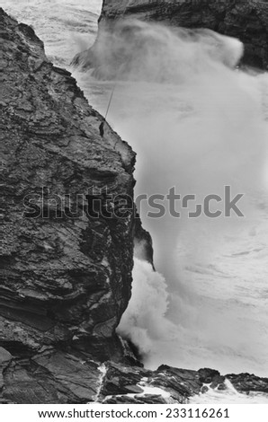 ALGARVE, PORTUGAL - JANUARY 24: Severe dramatic seascape with fisherman in Cape Saint Vicent cliffs on the Atlantic coast on January 24, 2009, Portugal