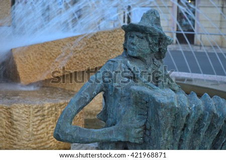ALGARVE, PORTUGAL - May 14, 2016: Loule's main roundabout statue. Landmarks, travel and vacation destinations. - stock photo