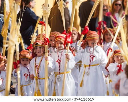 Algeciras, Spain - 20 March, 2016 unidentified children participate in Palm Sunday Procession Algeciras, Spain. The palm leaves represent the arrival of Jesus Christ on Palm Sunday in Jerusalem