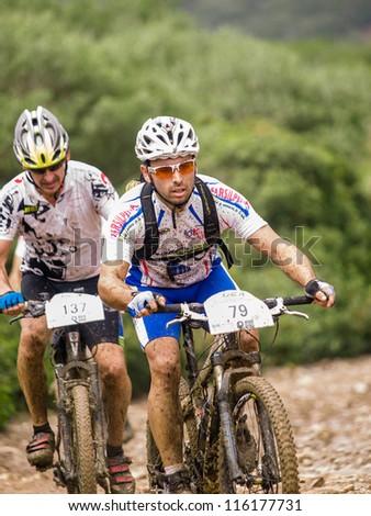 ALGECIRAS, SPAIN - SEPTEMBER 30: VIII MARATON ALCORNOCALES - ESTRECHO on September 30, 2012 in Algeciras, Spain.68 km Mountain bike marathon in the mountains Rider: BAUTISTA FERNANDEZ, JUAN FELIX - stock photo