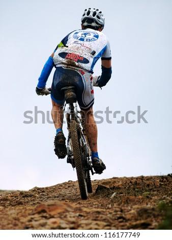 ALGECIRAS, SPAIN - SEPTEMBER 30: VIII MARATON ALCORNOCALES - ESTRECHO on September 30, 2012 in Algeciras, Spain.68 km Mountain bike marathon in the mountains Unknown rider climbs up a mountain - stock photo