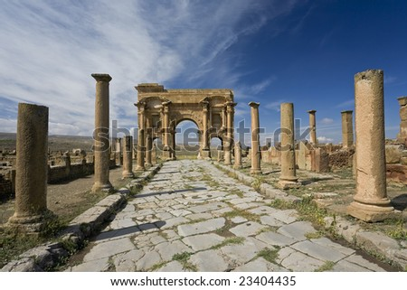 Algeria. Timgad (ancient Thamugadi or Thamugas). Decumanus street and surrounding colonnade terminated Trajan's Arch. Please see my other images of Roman places in Algeria, Tunisia and Libya - stock photo