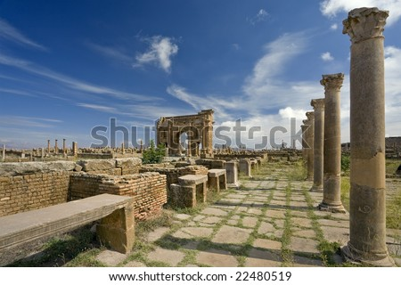 Algeria. Timgad (ancient Thamugadi or Thamugas). The Sertius market with stone stalls surrounded by Corinthian columns - stock photo