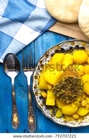 Algerian food tajine potato chickpeas meat stock photo 100 legal algerian food tajine potato with chickpeas and meat of sheep with arabic homemade bread forumfinder Images