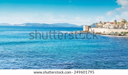 Alghero coastline under a cloudy sky. Shot in Sardinia, Italy - stock photo