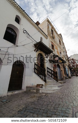 ALGIERS, ALGERIA - SEP 24, 2016: An ancient part of old city of Algeria, called casbah(kasaba).Old city is 122 metres (400 ft) above the sea. The casbah and the two quays form a triangle