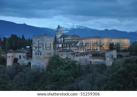 Alhambra Castle in Spain at dusk - stock photo
