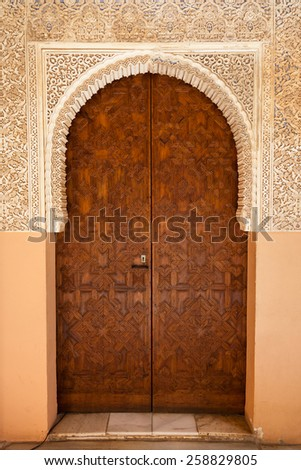 Alhambra de Granada. Ornated door in the Court of the Lions - stock photo