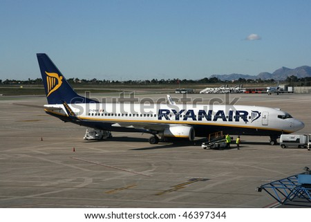 ALICANTE - NOVEMBER 25: Ryanair Boeing 737 aircraft on November 25, 2008 at Alicante Airport. Ryanair is currently the biggest airline in the world in terms of international passengers carried yearly. - stock photo