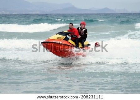 ALICANTE, SPAIN APRIL 20: A waverunner of the Spanish Service of Rescue is going along San Juan beach, on april 20, 2013 in Alicante. - stock photo