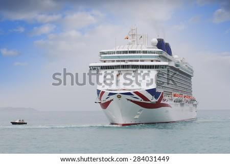 "ALICANTE, SPAIN â?? APRIL 22: The luxury cruise ""BRITANNIA"" of P&O Cruises Company entering in the port of Alicante; Spain; on april 22, 2015 in Alicante. - stock photo"