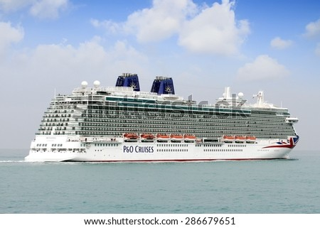 "ALICANTE, SPAIN   APRIL 22: The luxury cruise ""BRITANNIA"" of P&O Cruises Company entering in the port of Alicante; Spain; on april 22, 2015 in Alicante. - stock photo"