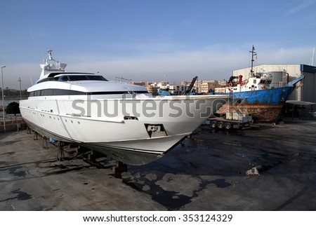 ALICANTE, SPAIN  DECEMBER 14: Yachts and boats in dry dock making reparations in the shipyard of Alicante harbor, Spain; on December 14, 2015 in Alicante.