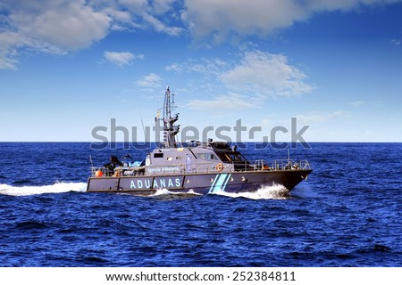 ALICANTE, SPAIN - JANUARY 24: A coastguard of the Spanish Customs Service makes its patrol along the coast of Altea in the Mediterranean province of Alicante, on january 24, 2015 in Alicante. - stock photo