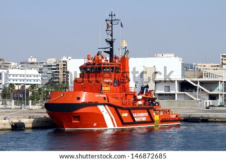 "ALICANTE, SPAIN � JULY 18: The rescue boat and tug support SAR MESANA"" is docked in the port of Alicante waiting orders, on July 18, 2013 in Alicante."