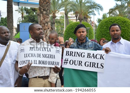 ALICANTE, SPAIN  - May 14: Assn of Nigerians protest for support against Boko Haram that's claimed responsibility for abducting over 200 girls from a school in Chibok, Nigeria. Alicante May 14, 2014. - stock photo