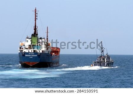 ALICANTE, SPAIN - MAY 10: Coastguard of the Spanish Customs Service controlling the cargo vessel â??Green Cedarâ?� close to the coast of Alicante in the Mediterranean, on may 10, 2015 in Alicante.