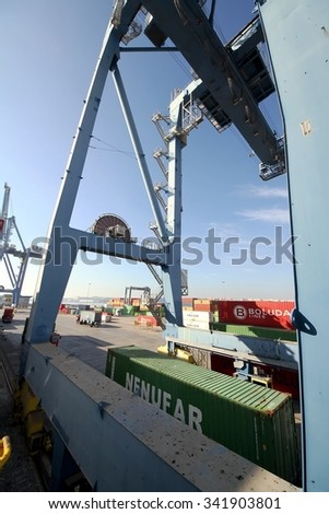 ALICANTE, SPAIN - NOVEMBER 16: Containers special crane downloading a containership of Boluda Lines in Alicante harbor, on november 16, 2015 in Alicante. - stock photo