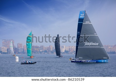 "ALICANTE,SPAIN–OCT. 7:Telefonica, Groupama and Puma Team participate in the race around the world ""Volvo Ocean Race 2011-2012"" in the first training in the bay of Alicante on October 7, 2011"