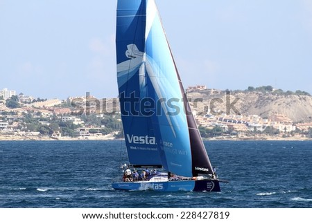 ALICANTE, SPAIN - OCTOBER 02th: Training day for the Open 65 sailboat class in Alicante bay, on october 02th, 2014 in Alicante. - stock photo