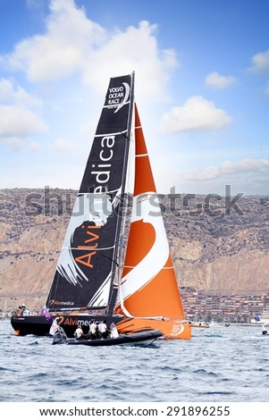 """ALICANTE, SPAIN - OCTOBER 04: The sail boat of the Team Alvimedica is sailing in the """"Volvo Ocean Race 2014-2015"""" in-port race in Alicante bay, on october 04, 2014 in Alicante. - stock photo"""