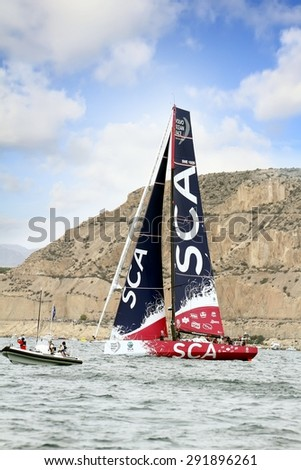 """ALICANTE, SPAIN - OCTOBER 04: The sail boat of the Team SCA is sailing in the """"Volvo Ocean Race 2014-2015"""" in-port race in Alicante bay, on october 04, 2014 in Alicante. - stock photo"""